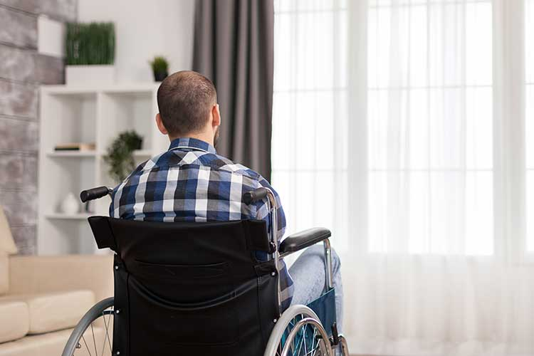 ndis participant looking sadly out of window