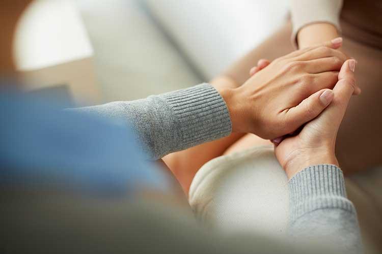positive behaviour support holding hands